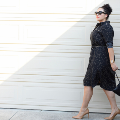 Tanesha Awasthi, also known as Girl With Curves, wearing a pajama-inspired midi dress, nude pumps and oversized tote bag.
